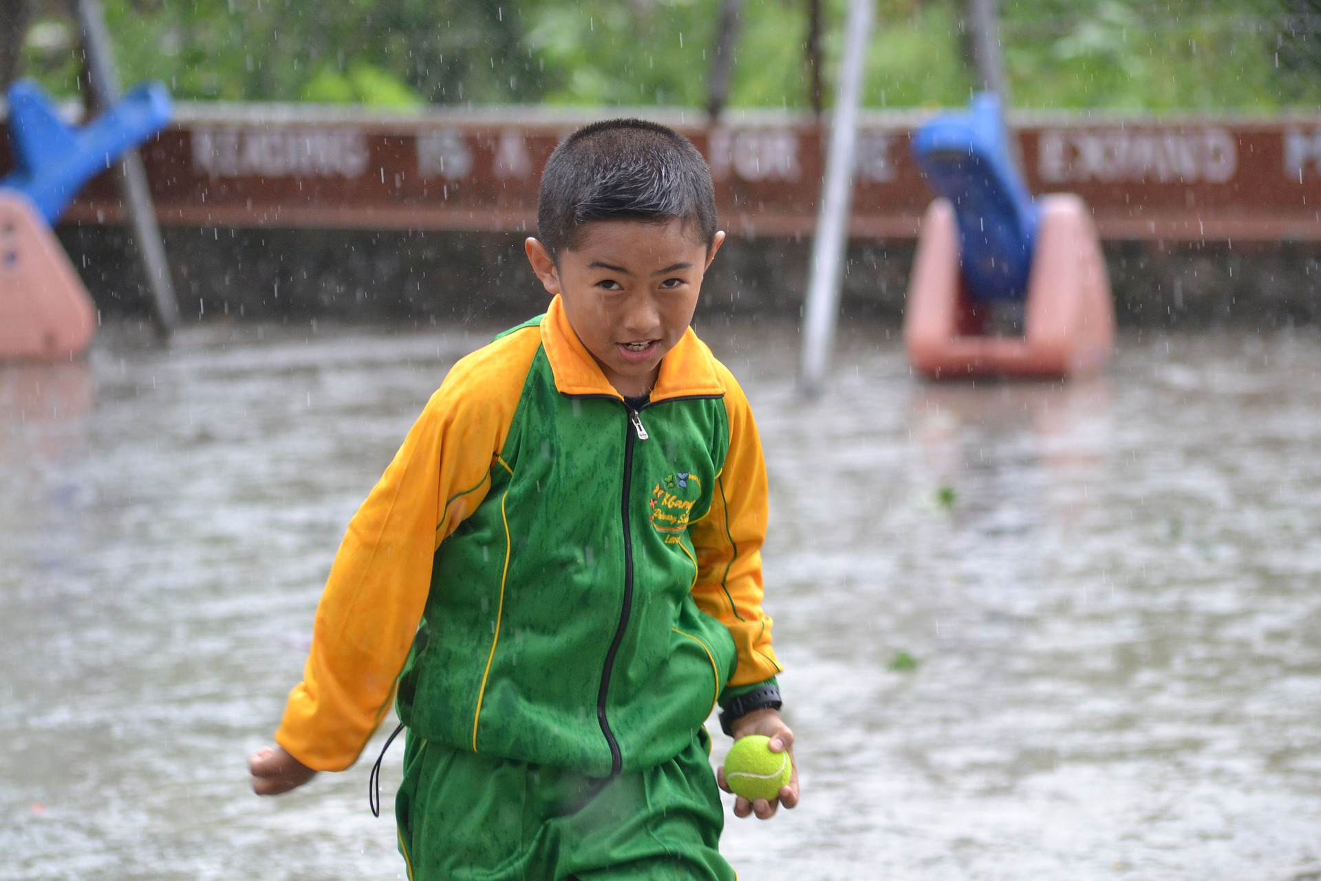 Asian boy with a ball in hands